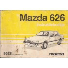 Mazda 626 Instructieboekje   Benzine Fabrikant 85 met gebruikssporen lichte vochtschade  Nederlands/Frans
